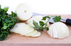 Sliced onion with knife. On white stock images