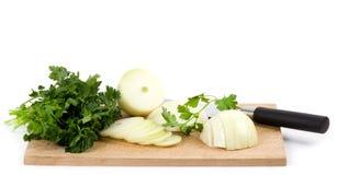Sliced onion with knife Stock Photos