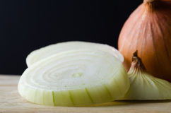 Sliced Onions Close Up with Black Background Stock Photo