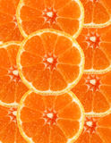Sliced orange background Stock Images