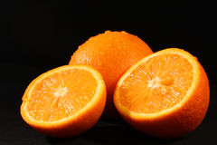 Sliced orange on black Stock Image