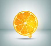 Sliced orange and a drop of orange juice Royalty Free Stock Images