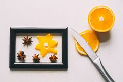Orange in frame. Sliced orange in a frame from a picture royalty free stock photography