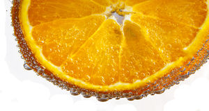 Sliced orange fruit in detail Stock Photos