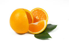 Sliced orange fruit with green leaves on white Stock Image
