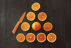 Sliced Orange Fruit With Knife Stock Photography