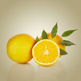 Sliced orange fruit with leaves Royalty Free Stock Photo