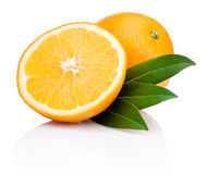 Sliced orange fruit with leaves isolated on white background Stock Photo