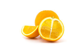 Sliced orange fruit with leaves isolated Stock Images
