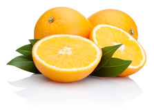 Sliced orange fruit with leaves  on white Stock Images