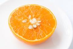 Sliced orange fruit Stock Photos