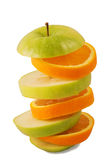 Sliced orange and green apple Stock Photography