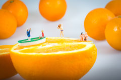 Sliced orange and inhabited by humans Stock Images