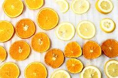 Sliced orange and lemon Stock Photos