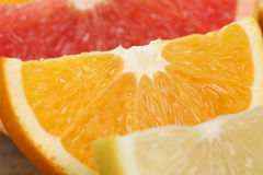 Sliced orange, lemon and grapefruit fruits Stock Photos