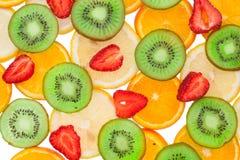 Sliced orange, lemon, strawberry and kiwi Royalty Free Stock Photos