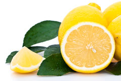 Sliced orange with lemons. Cross section of ripe orange with lemons and green leaves, isolated on white background Royalty Free Stock Photos