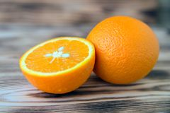 Sliced orange orange orange on wooden background macro photo. stock photography
