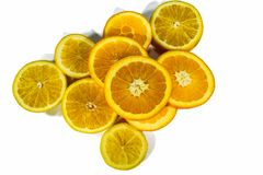 Sliced orange slices, stacked isolated on a white background stock photo