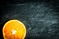 Sliced orange on a texture background Royalty Free Stock Images