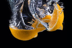 Sliced orange underwater isolated on black background.  Stock Photography
