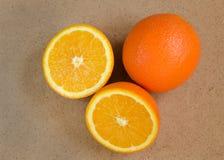 sliced orange on wood Stock Photos