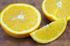 Sliced orange on a wooden table Royalty Free Stock Images