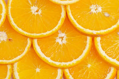 Sliced oranges background. Sliced juicy fresh delicious oranges background closeup Stock Photos