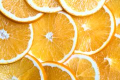 Sliced oranges background, bright fresh fruit cut into even slices Stock Photos