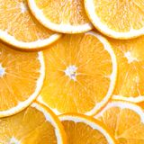 Sliced oranges background, bright fresh fruit cut into even slices Stock Photography