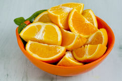 Sliced oranges in a bowl Royalty Free Stock Images