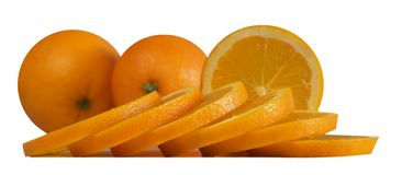 Sliced oranges on white isolated background. Sliced oranges on isolated white background close-up Stock Images