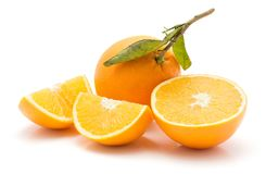 Orange, appelsin isolated. Sliced oranges isolated on white background one whole with green leaf one half two quarters Stock Images