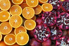 Sliced oranges and pomegranates Royalty Free Stock Image