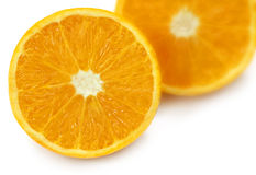 Sliced oranges with selective focus. Over white background stock images