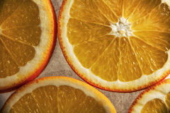 Sliced oranges. Stylized and toned image: added some grain, reduced saturation Stock Photos