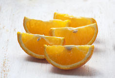 Sliced oranges  white background wooden Stock Images