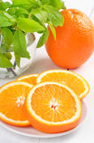 Sliced oranges and whole orange Royalty Free Stock Photo