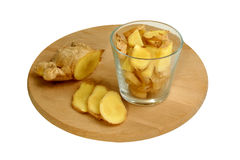 Sliced organic ginger in a glass. Some sliced organic ginger in a glass Stock Photos