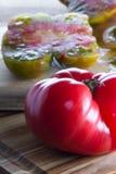 Sliced organic heirloom tomato Stock Photography