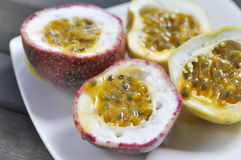 Sliced passion fruit. In the plate Stock Photos