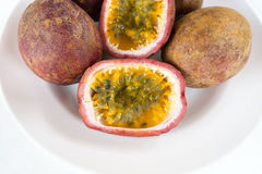 Sliced Passion Fruit on a Plate Royalty Free Stock Photos