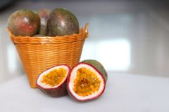 Sliced passion fruits with wood basket royalty free stock photo