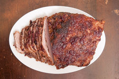 Sliced passover beef  brisket. Braised brisket made for Passover feast holiday with craberry topping Stock Photo
