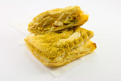 Sliced Pasty. Single sliced pasty on a napkin with a while background Royalty Free Stock Image