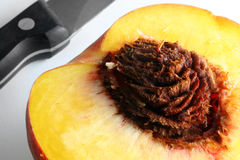 Sliced Peach. With knife, macro Royalty Free Stock Images