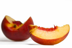 Sliced peach. On white background Royalty Free Stock Images