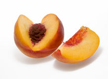Sliced peach. On white background Royalty Free Stock Photography
