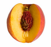 Sliced peach and clingstone. Sliced peach and stone isolated on white Royalty Free Stock Image