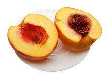 Sliced peach on the plate, isolated Stock Image